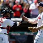 Cleveland Indians starting pitcher Justin Masterson, right, is congratulated by catcher Carlos Santana after the Indians defeated the New York Yankees 1-0 in the first baseball game of a dou …