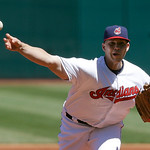 Cleveland Indians starting pitcher Justin Masterson delivers a pitch in the first inning in the first baseball game of a doubleheader against the New York Yankees, Monday, May 13, 2013, in C …