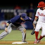 Philadelphia Phillies' Freddy Galvis, right, is tagged out at second base by Cleveland Indians second baseman Jason Kipnis after trying to advance on an RBI single in the eighth inning of a  …