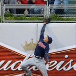 Cleveland Indians left fielder Michael Brantley cannot reach a home run by Philadelphia Phillies' Kevin Frandsen in the first inning of a baseball game, Tuesday, May 14, 2013, in Philadelphi …