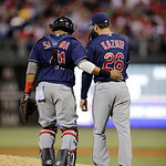 Cleveland Indians' Scott Kazmir, right, and Carlos Santana talk during an interleague baseball game against the Philadelphia Phillies, Tuesday, May 14, 2013, in Philadelphia. (AP Photo/Matt  …
