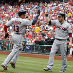 Cleveland Indians' Asdrubal Cabrera (13) and Jason Kipnis celebrate after they score on an RBI double by Mark Reynolds during the third inning of a interleague baseball game against the Phil …