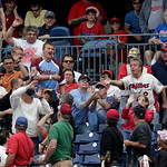 Fans chase a foul ball during Cleveland Indians Philadelphia Phillies interleague baseball game Wednesday, May 15, 2013, in Philadelphia.  (AP Photo/H. Rumph Jr)
