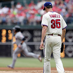 Philadelphia Phillies starting pitcher Cole Hamels walks back to the mound as Cleveland Indians' Mike Aviles round the bases after hitting a solo home run in the fourth inning of a interleag …