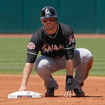 Miami Marlins' Brett Hayes sits at second base after being forced out against the Cleveland Indians in the first inning of an interleague baseball game in Cleveland on Sunday, May 20, 2012.  …