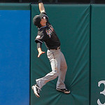 Miami Marlins center fielder Chris Coghlan cannot catch a RBI-double by Cleveland Indians' Jose Lopez in the ninth inning of an interleague baseball game in Cleveland, Sunday, May 20, 2012.  …