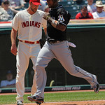 Miami Marlins' Hanley Ramirez, right, crosses the plate to score off teammate Greg Dobbs' double to center in the third inning against the Cleveland Indians in an interleague baseball game i …