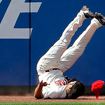 Cleveland Indians left fielder Johnny Damon flips upside down after slamming into the outfield wall on an RBI-double by Miami Marlins' Logan Morrison in the eighth inning of an interleague b …