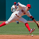 Cleveland Indians shortstop Asdrubal Cabrera cannot reach a ground ball single by Miami Marlins' Hanley Ramirez in the third inning of an interleague baseball game in Cleveland, Sunday, May  …