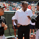 Former Cleveland Indians great Joe Carter, center, shares a laugh with Miami Marlins manager Ozzie Guillen, right, and Marlins bench coach Joey Cora before throwing out the ceremonial first  …