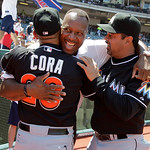 Former Cleveland Indians great Joe Carter, center, greets Miami Marlins manager Ozzie Guillen, right, and Marlins bench coach Joey Cora before throwing out the ceremonial first pitch before  …