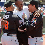 Former Cleveland Indians great Joe Carter, center, shares a laugh with Miami Marlins manager Ozzie Guillen, right and Marlins bench coach Joey Cora before throwing out the ceremonial first p …