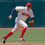 Cleveland Indians shortstop Asdrubal Cabrera cannot reach a ground ball single by Miami Marlins' Hanley Ramirez in the third inning of an interleague baseball game in Cleveland on Sunday, Ma …
