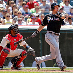 Miami Marlins' Greg Dobbs, right, watches his double to right against the Cleveland Indians in the eighth inning of an interleague baseball game in Cleveland, Sunday, May 20, 2012. Indians c …