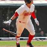 Cleveland Indians' Shin-Soo Choo watches his fly ball in the ninth inning against the Miami Marlins in an interleague baseball game in Cleveland on Sunday, May 20, 2012.  (AP Photo/Amy Sance …