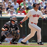 Cleveland Indians' Johnny Damon hits a fly ball against the Miami Marlins in the seventh inning of an interleague baseball game in Cleveland on Sunday, May 20, 2012.  Behind the plate are ho …