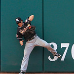 Miami Marlins center fielder Chris Coghlan cannot catch this RBI double by Cleveland Indians' Jose Lopez in the ninth inning of an interleague baseball game in Cleveland on Sunday, May 20, 2 …