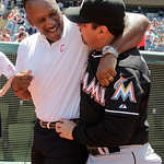 Former Cleveland Indians great Joe Carter, left, greets Miami Marlins manager Ozzie Guillen, before throwing out the ceremonial first pitch before the Cleveland Indians face the Miami Marlin …