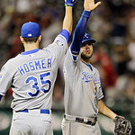 Kansas City Royals first baseman Eric Hosmer (35) and third baseman Mike Moustakas celebrate after an 8-2 win over the Cleveland Indians in a baseball game Tuesday, May 29, 2012, in Clevelan …