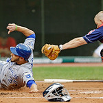 Kansas City Royals&#039; Eric Hosmer (35) slides under the tag of Cleveland Indians catcher Luke Carlin to score on a ground ball by Humberto Quintero in the second inning of a baseball game Tues &#8230;