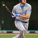 Kansas City Royals' Mike Moustakas watches his two-run single off Cleveland Indians starting pitcher Justin Masterson in the second inning of a baseball game Tuesday, May 29, 2012, in Clevel …