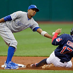 Cleveland Indians' Shin-Soo Choo (17) steals second base as Kansas City Royals shortstop Alcides Escobar bobbles the throw in the first inning of a baseball game Tuesday, May 29, 2012, in Cl …