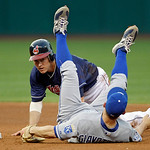 Cleveland Indians' Luke Carlin looks to first after upending Kansas City Royals second baseman Johnny Giavotella in the fourth inning of a baseball game Tuesday, May 29, 2012, in Cleveland. …