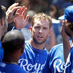 Kansas City Royals' Alex Gordon is congratulated in the dugout after scoring on a single by Johnny Giavotella during the fourth inning of a baseball game against the Cleveland Indians in Cle …