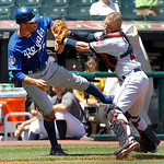 Kansas City Royals' Jeff Francoeur, left, is caught in a run down and tagged out between third and home, by Cleveland Indians catcher Luke Carlin in the second inning of a baseball game in C …