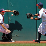 Cleveland Indians left fielder Shelley Duncan, left, and center fielder Michael Brantley try to corral an RBI double off the left center wall by Kansas City Royals' Alex Gordon in the fourth …