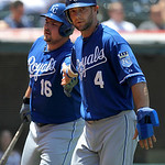 Kansas City Royals' Alex Gordon (4)  is congratulated by teammate Billy Butler after scoring on a single by teammate Johnny Giavotella against the Cleveland Indians in the fourth inning of a …