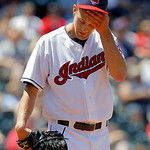 Making his Major League debut, Cleveland Indians pitcher Scott Barnes wipes his brow against the Kansas City Royals in the sixth inning of a baseball game in Cleveland on Wednesday, May 30,  …