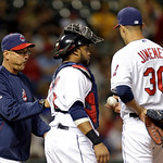 Cleveland Indians manager Terry Francona, left, takes the ball from Cleveland Indians starting pitcher Ubaldo Jimenez (30) in the sixth inning of a baseball game against the Oakland Athletic …