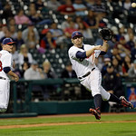 Cleveland Indians third baseman Mark Reynolds throws out Oakland Athletics' Luke Montz as relief pitcher Joe Smith (38) watches in the ninth inning of a baseball game Monday, May 6, 2013, in …