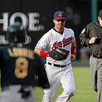 Cleveland Indians first baseman Nick Swisher runs to first to get Oakland Athletics' Jed Lowrie (8) on a groundout in the first inning of a baseball game Monday, May 6, 2013, in Cleveland. ( …