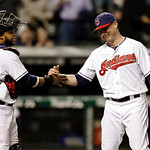 Cleveland Indians catcher Carlos Santana, left, celebrates with relief pitcher Joe Smith after the final out in a 7-3 win over the Oakland Athletics in a baseball game, Monday, May 6, 2013,  …