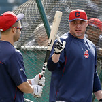 Cleveland Indians' Jason Giambi, right, talks with Nick Swisher during batting practice before a baseball game against the Oakland Athletics Monday, May 6, 2013, in Cleveland. (AP Photo/Mark …