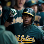 Oakland Athletics' Yoenis Cespedes is congratulated in the dugout after a solo home run against the Cleveland Indians in the fourth inning of a baseball game Monday, May 6, 2013, in Clevelan …