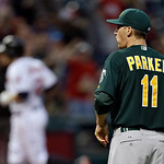 Oakland Athletics starting pitcher Jarrod Parker (11) looks in after giving up a solo home run to Cleveland Indians' Mark Reynolds in the fifth inning of a baseball game Monday, May 6, 2013, …
