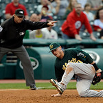 Oakland Athletics third baseman Josh Donaldson snares a line drive off the bat of Cleveland Indians' Carlos Santana to end the third inning of a baseball game Monday, May 6, 2013, in Clevela …