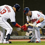 Cleveland Indians' Nick Swisher greets Asdrubal Cabrera (13) after Cabrerra's solo home run in the fifth inning of a baseball game against the Oakland Athletics Monday, May 6, 2013, in Cleve …