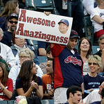 A fan cheers for Cleveland Indians' Nick Swisher as he comes to the plate in the third inning of a baseball game against the Oakland Athletics Monday, May 6, 2013, in Cleveland. (AP Photo/Ma …