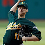 Oakland Athletics starting pitcher Jarrod Parker delivers against the Cleveland Indians in the first inning of a baseball game Monday, May 6, 2013, in Cleveland. (AP Photo/Mark Duncan)
