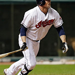 Cleveland Indians' Jason Giambi singles off Oakland Athletics relief pitcher Chris Resop with the bases loaded to drive in two runs in the seventh inning of a baseball game, Monday, May 6, 2 …