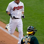 Cleveland Indians' Jason Kipnis jogs home after a solo home run against the Oakland Athletics in the first inning of a baseball game Monday, May 6, 2013, in Cleveland. (AP Photo/Mark Duncan)
