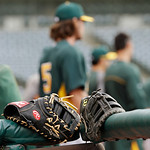 The Oakland Athletics take the field for batting practice before a baseball game against the Cleveland Indians Monday, May 6, 2013, in Cleveland. (AP Photo/Mark Duncan)