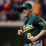 Oakland Athletics manager Bob Melvin jogs back to the dugout after a pitching change in the seventh inning of a baseball game against the Cleveland Indians Monday, May 6, 2013, in Cleveland. …