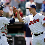 Cleveland Indians catcher Yan Gomes, left, celebrates with relief pitcher Scott Barnes after a 9-2 win over the Oakland Athletics in a baseball game Thursday, May 9, 2013, in Cleveland. (AP  …