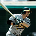 Oakland Athletics' Eric Sogard singles to drive in a run against Cleveland Indians relief pitcher Matt Albers in the eighth inning of a baseball game Thursday, May 9, 2013, in Cleveland. The …