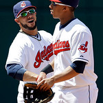 Cleveland Indians shortstop Mike Aviles, left, and left fielder Michael Brantley celebrate after a 9-2 win over the Oakland Athletics in a baseball game Thursday, May 9, 2013, in Cleveland.  …